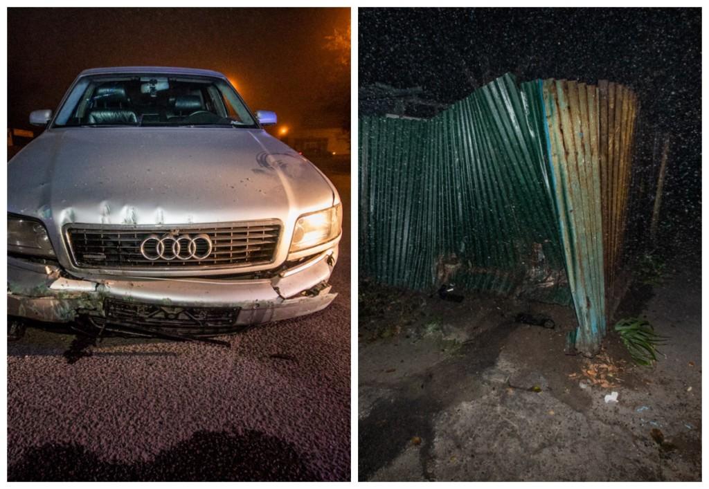 Водитель Audi врезался в забор жилого дома