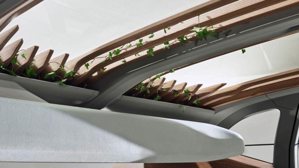 Одной из самых концептуальных деталей AI: Me является использование настоящих растений среди деревянных стоек крыши